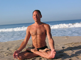 michael arnoff meditating on beach